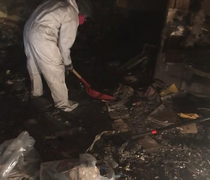 This pictures shows the basement of a home full of soot and debris before fire cleanup begins.